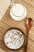 Buckwheat kasha with milk on a table with napkin poster