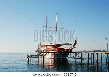 Yacht At The Pier On Mediterranean Turkish Resort, Antalya, Turkey