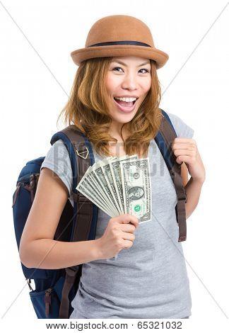 Asian female traveler holding cash