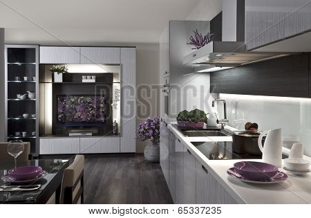 modern kitchen and living room with table served for dinner