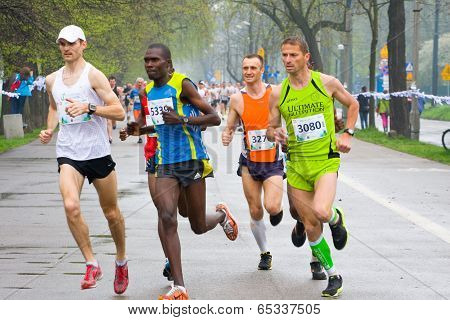 Krakow, Poland - April 28 : Cracovia Marathon. Andrzej Lachowski And Zdravko Milovic And Other Runne