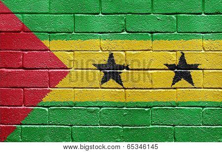 Flag of Sao Tome and Principe painted onto a grunge brick wall
