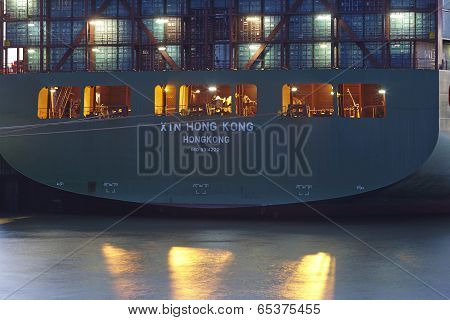 Hamburg - Container Vessel At The Port In The Evening