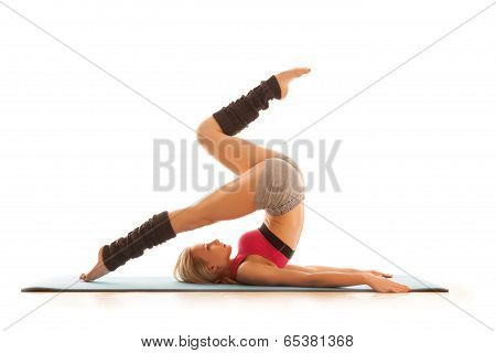 Young Woman Doing Stretching Exercise At Home
