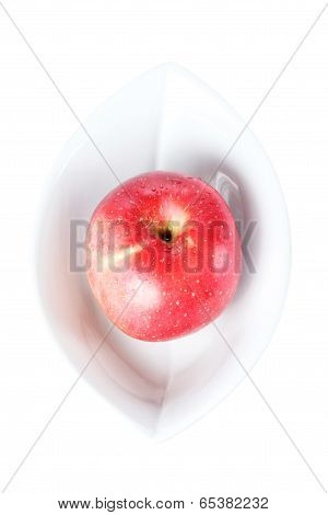Red Apple In White Plate Isolated On A White Background