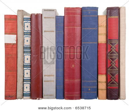pile of old books on a white background poster