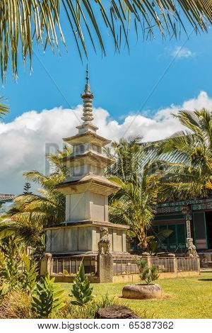Large Pagoda statue on the grounds of Mu Ryang Sa Temple meaning Broken Ridge Temple a Korean buddhist temple on Oahu Hawaii poster