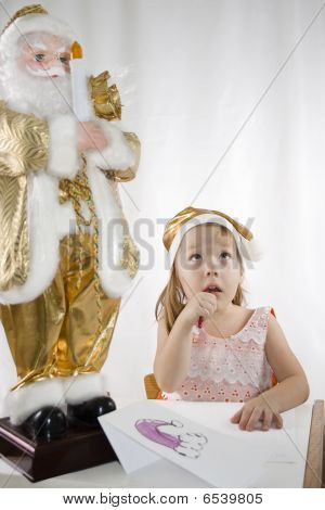Small Girl Holds Gift And Kisses Santa