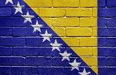 Flag of Bosnia and Herzegovina painted onto a grunge brick wall poster