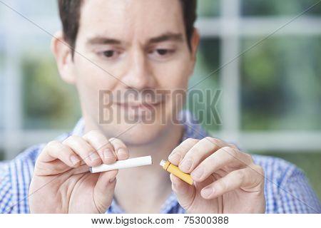 Man Using Electronic Cigarette To Stop Smoking