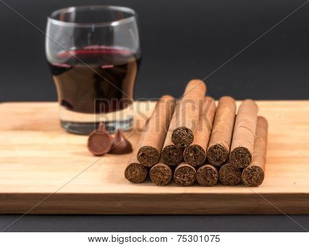 Worldwide famous Cuban cigars over wood with chocolates and red wine hand rolled natural habanos an unhealthy tradition in the Caribbean Island poster