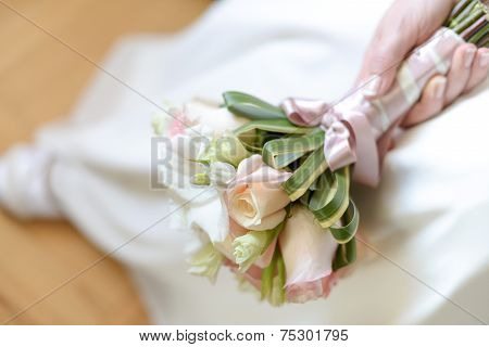 Bride with flower bouquet of pink roses