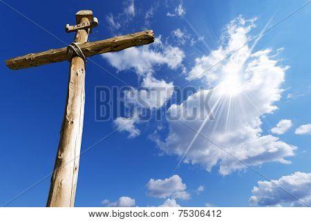 Wooden Cross Against A Blue Sky