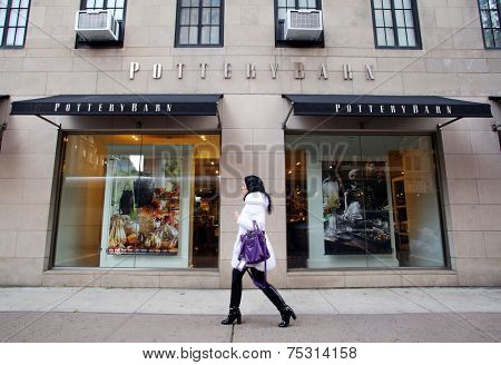 NEW YORK CITY - OCT. 20, 2014: Pedestrians walk past a Pottery Barn store in New York City on Monday, October 20, 2014. Pottery Barn is a U.S.-based home furnishing store chain