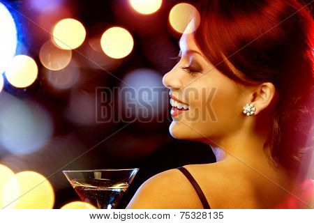 luxury, vip, nightlife, party concept - beautiful woman in evening dress with cocktail