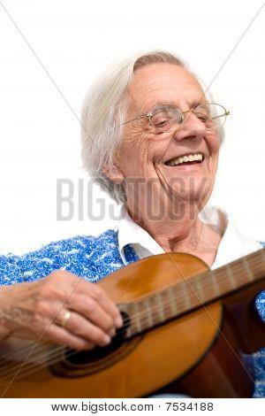 Elder Woman Playing Guitar.