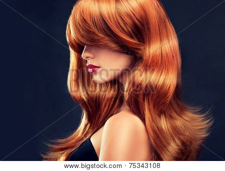 Model with long curly red hair