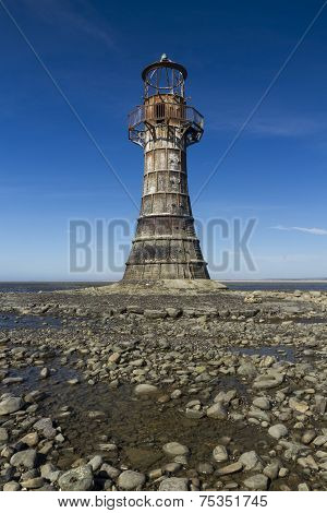 Ruined Derelict Lighthouse, Whiteford Sands, Gower Peninsula, South Wales. Blue Sky.