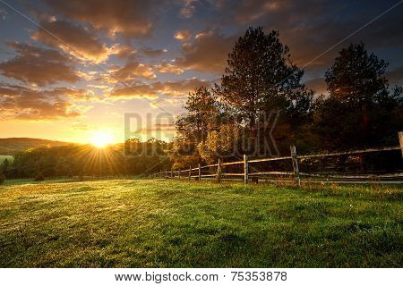 Picturesque landscape fenced ranch at sunrise