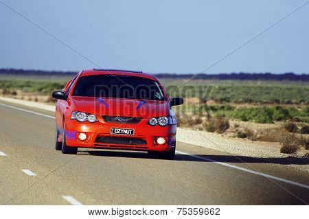 Red Car At Full Speed
