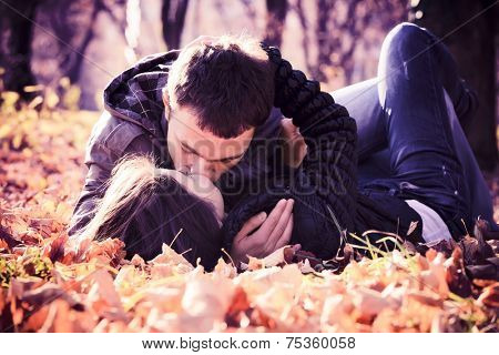 Kissing young couple in love in the autumn park
