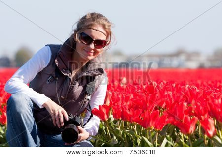 Young Girl In Fields Of Flowers