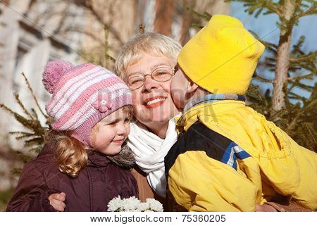 happy grandmather and grandsons in park