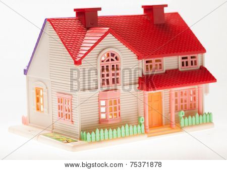 Dollhouse close up on a light background