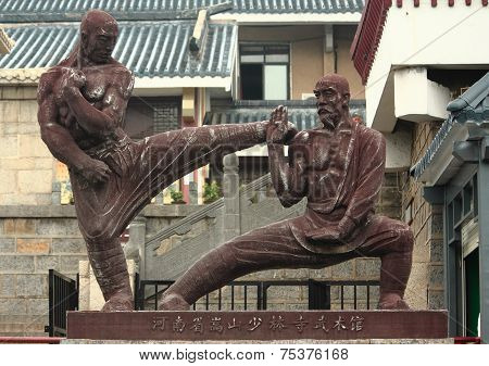 statue of two fighters near Shaolin temple