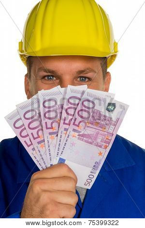 a worker in a trade or business (craftsmen) with banknotes in his hand