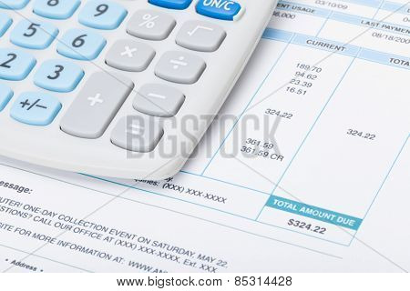 Calculator With Utility Bill Under It