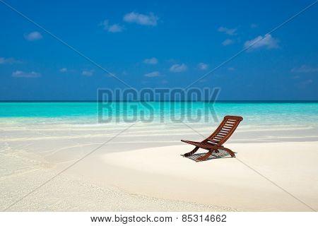 Beach Lounger On Sand Beach.