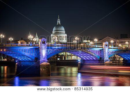 St Paul's Cathedral famous landmark of London poking behind Southwark bridge London England. poster