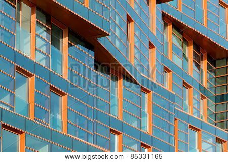 A modern building mirror facade in blue tone poster