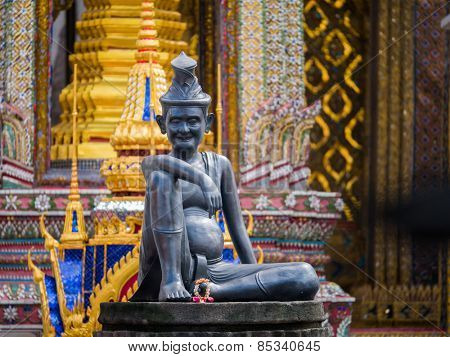 statue of hermit located in front of temple, wat phra keaw, Bangkok Thailand