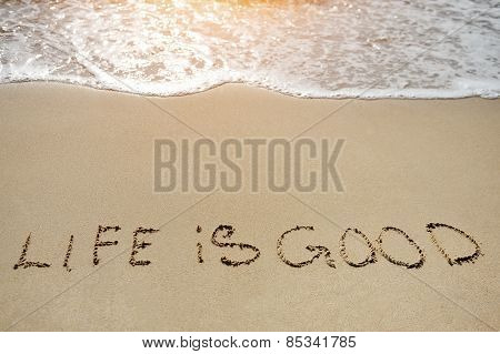 Life Is Good Written On Sand Beach - Positive Thinking Concept
