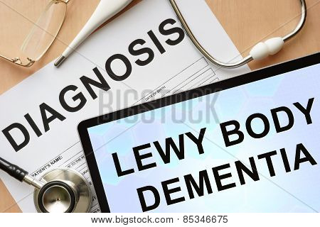 Tablet with diagnosis Lewy body dementia and stethoscope.