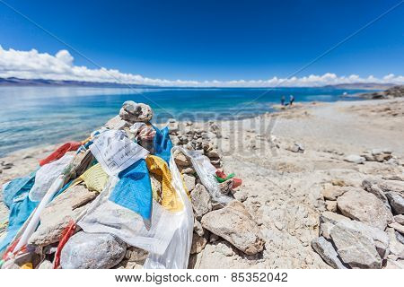 Marnyi Stone With Sutra Streamers On The Lakeside Of Namtso
