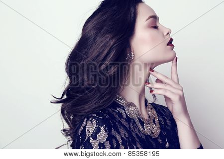 Sensual Woman With Dark Hair And Bright Makeup With Bijou