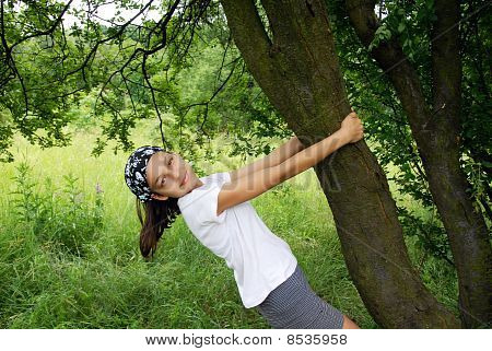Teenage Girl By Tree