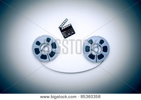 8Mm Blue Movie Reels And Little Clapper Vintage Color Effect