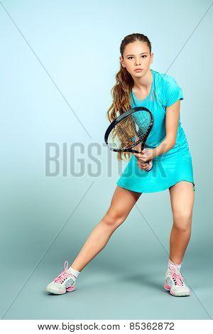 Full length portrait of a girl tennis player. Studio shot. poster