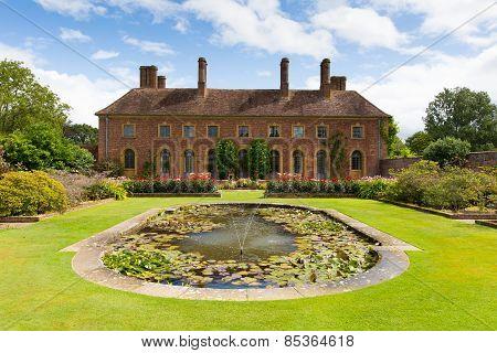 Strode House Barrington Court near Ilminster Somerset England uk with Lily pond garden