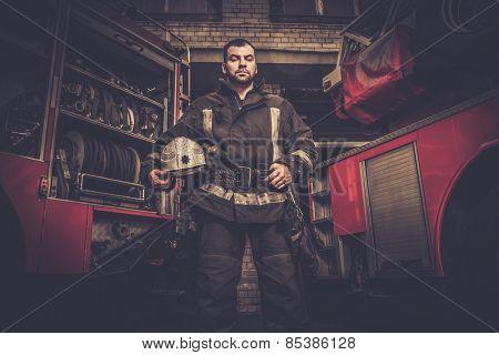 Firefighter near truck with equipment