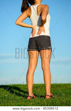 Female Athlete Suffering Low Back Pain