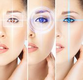Women with a digital laser hologram on their eyes (ophthalmology, eye surgery and identity scanning technology concept) poster