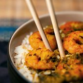 Curry prawns shrimp and rice in a bowl Caribbean food poster