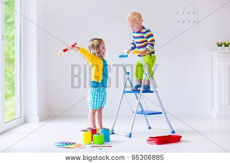 Children Painting Walls At Home