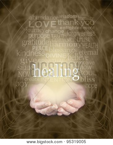 Female cupped hands with the word 'healing' floating above surrounded by a healing word cloud on a swirling misty sepia colored energy background poster