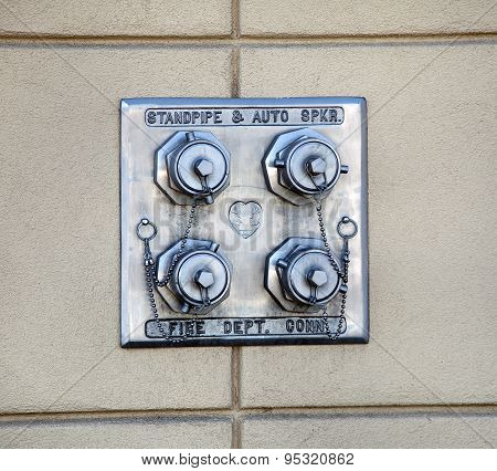 Standpipe FDC, Dry standpipe outlets by a driveway at a building, four fire hose connections on the